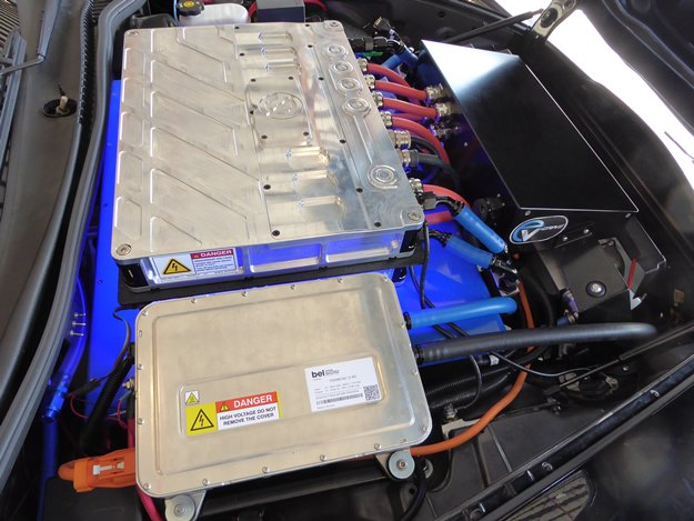 The view under the hood. The boxes on top are the controllers; the blue thing underneath is one of five battery packs. Space is at a premium in an '06 'Vette.(Jim Motavalli photo)